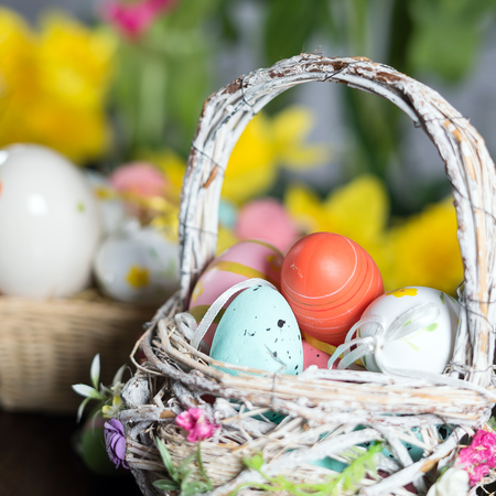 Happy easter. Easter eggs and easter decoration on the wooden table.