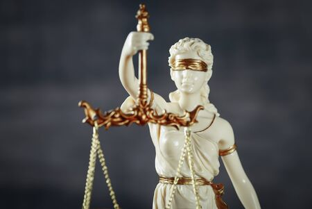 Law and Justice concept image, Lady Justice and gavel on rustic brown background Фото со стока