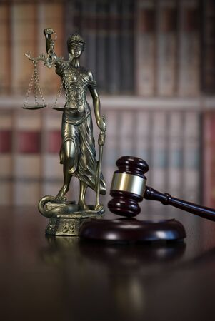 Law and Justice concept image with books on background Фото со стока