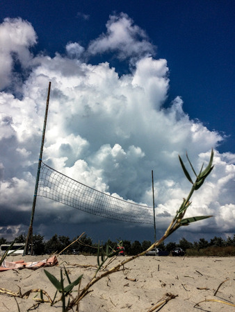 volleyball on the beach with clouds on background, cumulus clouds before thunderstorm