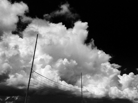 black and white clouds and sky Cumulus and volleyball net concept of sport photography, motivation
