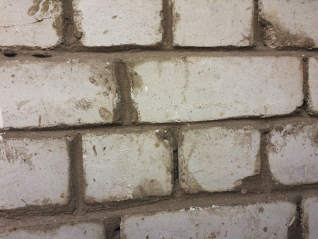 Many dark brick at the wall texture background