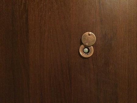 Lens little peephole on new wooden door