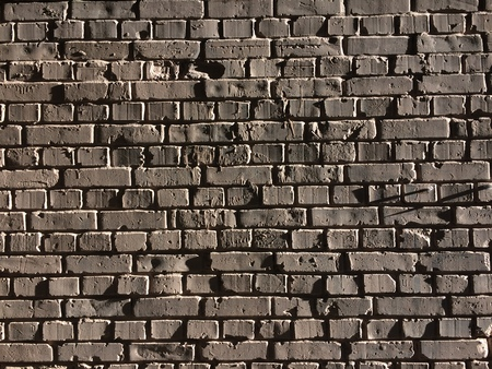 Many dark brick at the wall texture background. 版權商用圖片