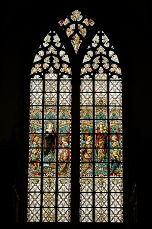 gothic window: Stained glass window in Grand Sablon church in Brussels, Belgium
