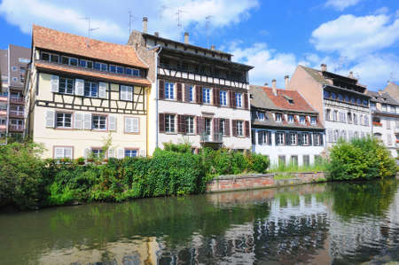 View from river of tourist area Petite France in Strasbourg, France with reflections in water