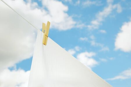 bedsheets: Fresh washed bed sheets drying on rope in bright day