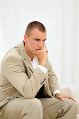 rancor: Young job seeker thinking about mistakes in his interview Stock Photo