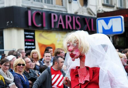 BRUSSELS, BELGIUM-MAY 19  An unknown participant plays weird woman during Zinneke Parade on May 19, 2012 in Brussels  This parade is a biennial urban artistic and free-attendance event Stock Photo - 16745782