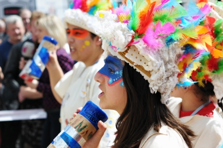 BRUSSELS, BELGIUM-MAY 19: An unknown participant with colored face greets visitors during Zinneke Parade on May 19, 2012 in Brussels. This parade is a biennial urban artistic and free-attendance event with theme for year 2012 Disorder or Chaos attracted m Stock Photo - 16722071