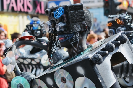 BRUSSELS, BELGIUM-MAY 19: An unknown participant demonstrates his costume of robot during Zinneke Parade on May 19, 2012 in Brussels. This parade is a biennial urban artistic and free-attendance event with theme for year 2012 Disorder or Chaos Stock Photo - 16722084