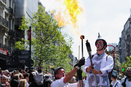 BRUSSELS, BELGIUM-MAY 19: Unknown participants play with fire during Zinneke Parade on May 19, 2012 in Brussels. This parade is a biennial urban free-attendance event Stock Photo - 16722065