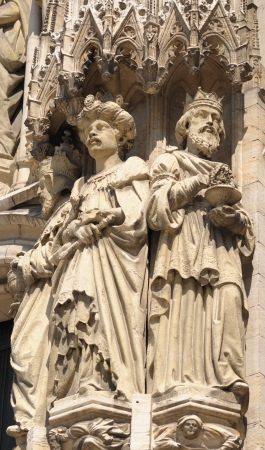 Realistic gothic statues of personages from Bible on exterior walls of Cathedral of St. Michael and St. Gudula in Brussels photo