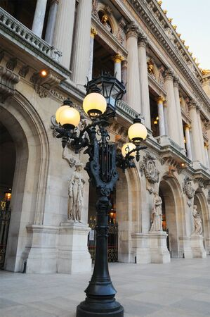 Stylish old lantern near French Opera building in Paris, France in evening