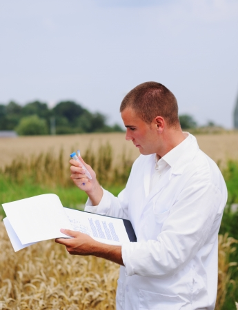 scientist man: Scientist in the field collects samples for experiments
