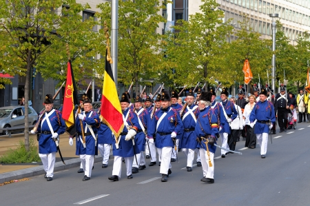 BRUSSELS, BELGIUM-SEPTEMBER 22: Performers in uniforms of 1830 participate in a parade to commemorate the battle for Independence of Belgium in 19 century on September 22, 2012 in Brussels.  Stock Photo - 16869104