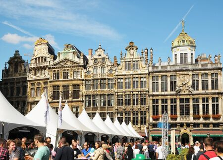BRUSSELS, BELGIUM-SEPTEMBER 1: Tourists from the entire world visited Grand Place during Belgian Beer Weekend started on September 1, 2012 in Brussels. This is annual public event dedicated to Belgian beer.  Stock Photo - 16869097