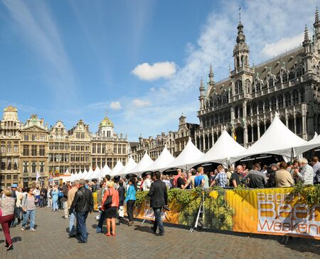 BRUSSELS, BELGIUM-SEPTEMBER 1: Thousands of tourists were attracted to Grand Place by Belgian Beer Weekend started on September 1, 2012 in Brussels. This is annual public event dedicated to Belgian beer. Stock Photo - 16869070