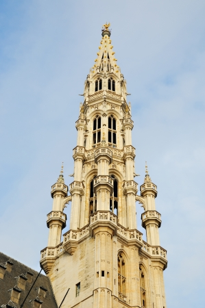Closeup image of medieval tower of City Hall on Grand Place in Brussels