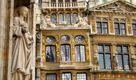 Details of medieval architecture of building on Grand Place in Brussels with realistic gothic statue Stock Photo - 16869020