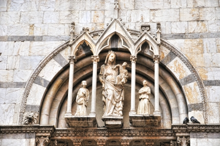 Details of entry in gothic catholic church in Pisa, Italy photo