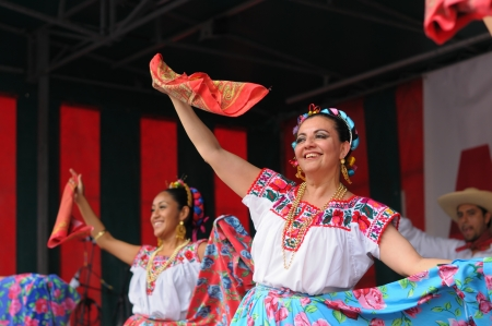 BRUSSELS, BELGIUM-SEPTEMBER 15: Dancers of Xochicalli Mexican folkloric ballet perform in a concert on Grand Place during 12 edition of Folklorissimo Festival on September 15, 2012 in Brussels.