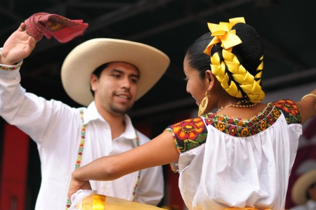 BRUSSELS, BELGIUM-SEPTEMBER 15: Dancers of Xochicalli Mexican folkloric ballet show national dance in a concert on Grand Place during 12 edition of Folklorissimo Festival on September 15, 2012 in Brussels.