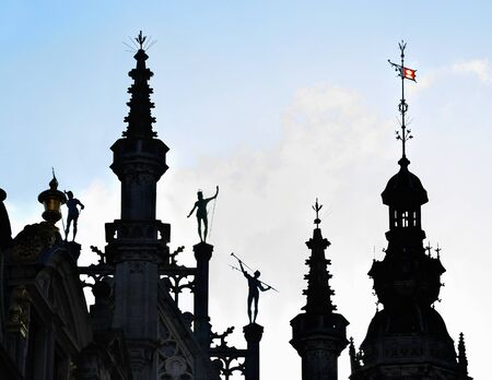 Famous neogothic silhouettes against sun of medieval building on Grand Place in Brussels, Belgium Stock Photo - 16919022