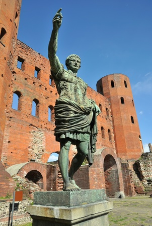 statue of roman imperor on front of porta palatina in turin in clear day Stock Photo - 16947941
