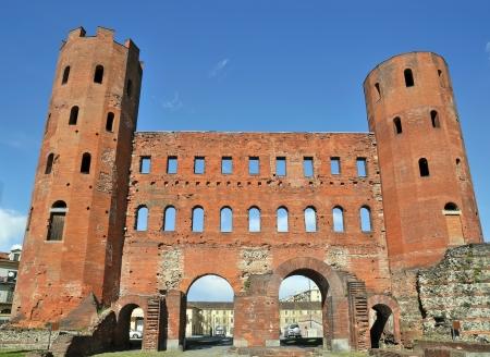 augustus: Roman gates Porta Palatina on blue sky in center of Turin, Italy