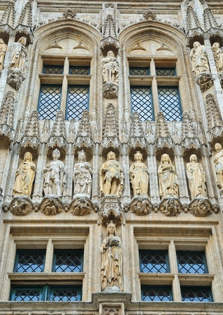 gothica: Wall of medieval gothic city hall in Grand Place in Brussels with rows of statues Stock Photo