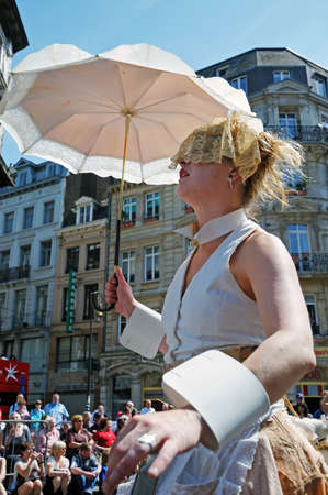 BRUSSELS, BELGIUM-MAY 22  Unidentified participant plays in composition during Zinneke Parade on May 22, 2010 in Brussels, Belgium  This parade is a biennial free-attendance artistic event