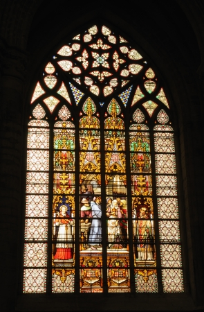 BRUSSELS, BELGIUM-FEBRUARY 14: Stained glass window with medieval scene in Cathedral of St. Michael and St. Gudula on February 14, 2009 in Brussels. The cathedral was founded in 1047