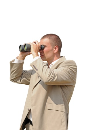 Young person in office suit watching through binoculars in sunny day isolated on white