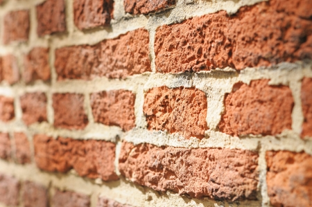 Angle view of old red brick wall in sunny day with shallow DOF photo
