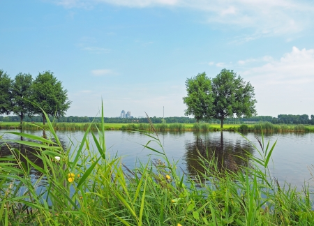 Typical landscape with a river in Netherlands, near Amsterdam in calm summer day Stock Photo