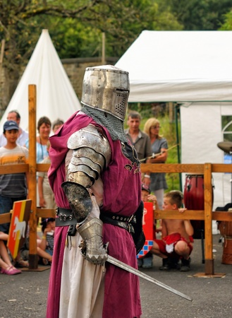 wallonie: REMOUCHAMPS, BELGIUM-AUGUST 19  Unidentified performer shows medieval costume of knights during Medieval Celebration on August 19, 2012 in Remouchamps  Editorial