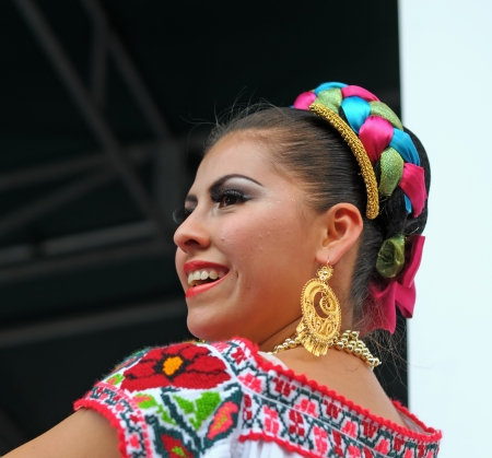 BRUSSELS, BELGIUM-SEPTEMBER 15  Xochicalli Mexican folkloric group performs in a concert on Grand Place during 12 edition of Folklorissimo Festival on September 15, 2012 in Brussels, Belgium