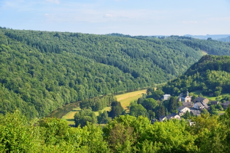 wallonie: Landscape with hills and river near Kermesse Rochehaut in Walloon, province Namur in Belgium in a calm summer day Stock Photo