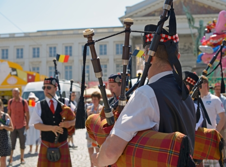 BRUSSELS, BELGIUM - JULY, 21: Unidentified performers in Scottish costumes participate in celebrations on street during National Day of Belgium on July 21, 2013 in Brussels