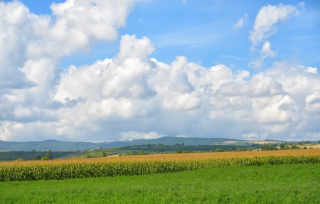 Rural landscape of Auvergne region in Massif Central of France in bright autumn day with beautiful clouds photo