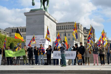 activists: BRUSSELS, BELGIUM - SEPTEMBER, 15: Activists of Tibetan Community demonstrate for freedom of Tibet on Place de lAlbertine on September 15, 2013 in Brussels.  Editorial