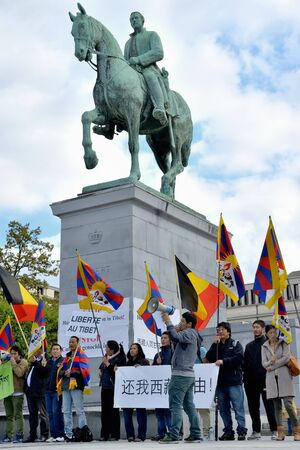 BRUSSELS, BELGIUM - SEPTEMBER, 15: Activists of Tibetan Community demonstrate for freedom of Tibet on Place de lAlbertine on September 15, 2013 in Brussels