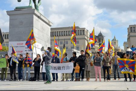 BRUSSELS, BELGIUM - SEPTEMBER, 15: Activists of Tibetan Community demonstrate for freedom of Tibet on Place de lAlbertine on September 15, 2013 in Brussels.