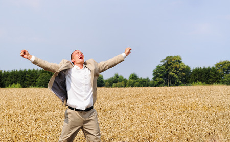 picknic: Happy young person shouting in the wheat field