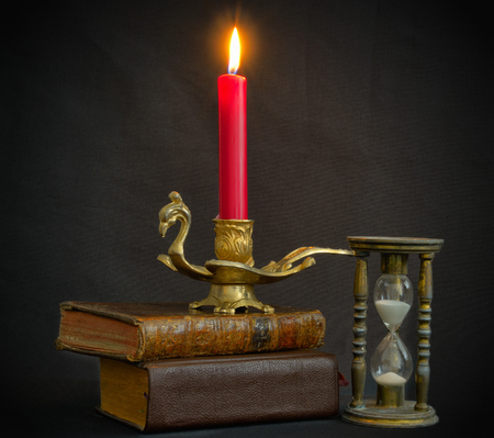 Magic books hourglass and candle in vintage set for Halloween photo