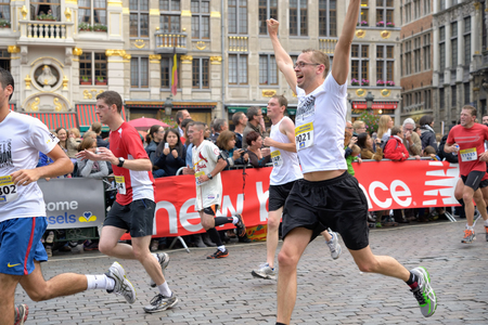 BRUSSELS, BELGIUM-OCTOBER 6  Participants arrive to the finish at Grand Place during Brussels Marathon and Half Marathon on Octorber 6, 2013 in Brussels