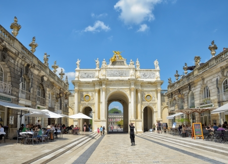 NANCY, FRANCE - JULY, 7: Tourists arrive to Triumphal Arch and Place Stanislas in historical center of Nancy on July 7, 2013 in Nancy.This square is in World Heritage Sites list of UNESCO since 1983