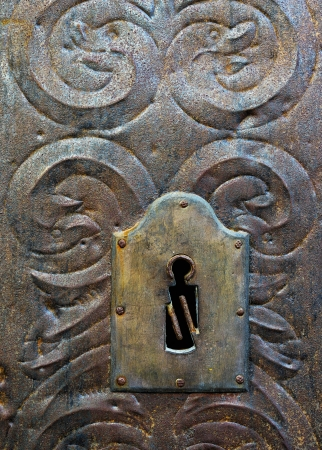 medieval blacksmith: Metal medieval door with key hole  Stock Photo