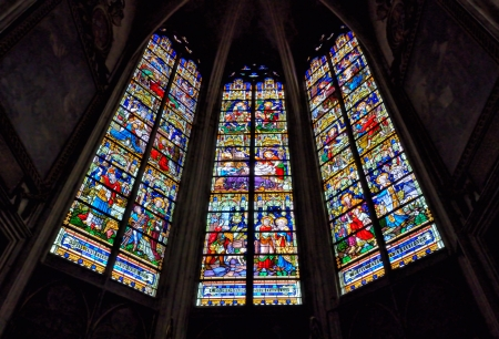 consecrated: MECHELEN, BELGIUM-DECEMBER 29: Stained glass windows in St. Rumbolds Cathedral on December 29, 2013 in Mechelen, Belgium. This cathedral was consecrated in 1312 and has 97 meters tower. Editorial
